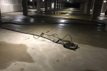 Reclamation pressure washing new parking garage at Redmond WA