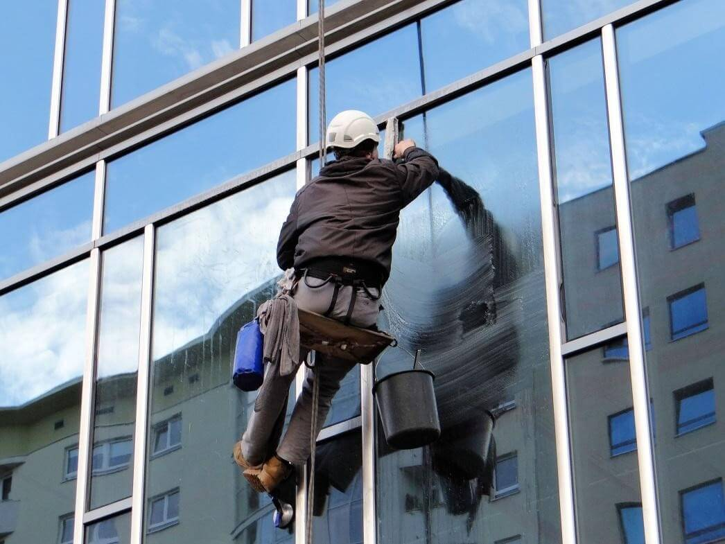 How do professional window washers clean windows?